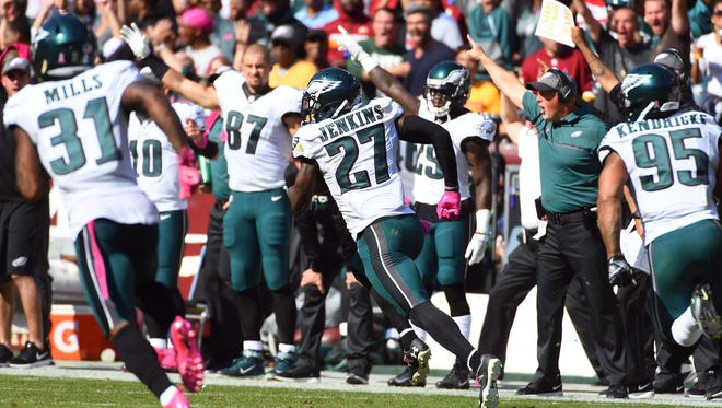 Philadelphia Eagles safety Malcolm Jenkins (27) returns an interception for a touchdown against the Washington Redskins during the first half at FedEx Field.