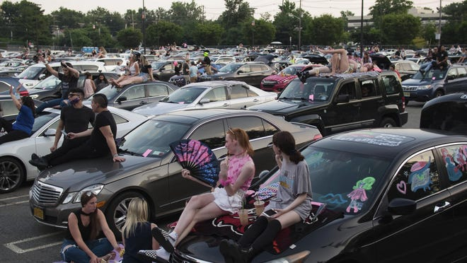 This photo provided by Polk Imaging shows Drive 'N Drag at Westfield Garden State Plaza, in Paramus, N.J.  After being closed for months due to the pandemic, malls are bringing all types of drive-in entertainment to their massive parking lots, hoping to lure people back to their properties.