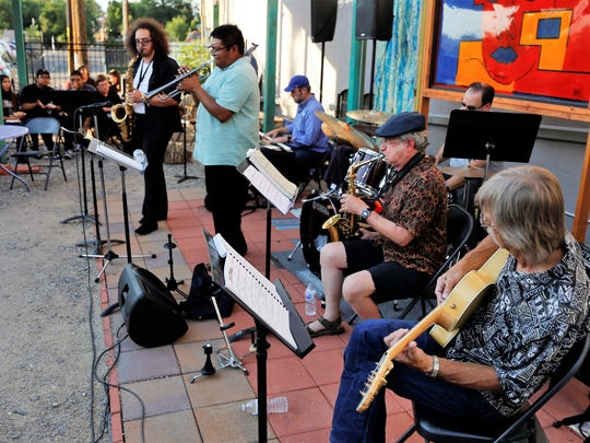 Justin Medine, left, Delbert Anderson, Sheldon Pickering, Mark Smith, Teun Fetz and Gordon Peck perform during a jazz jam session on July 11 at the Studio 116 pocket park.
