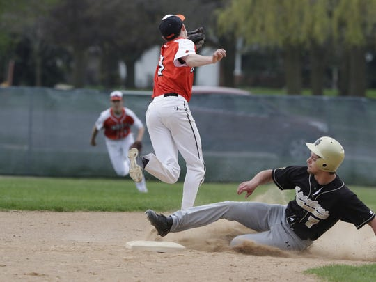 Oshkosh North's Jordan Roen slides safely into second with a stolen base against Kaukauna on Thursday.