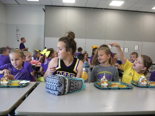 Indianola junior Liz Leech chats with elementary students