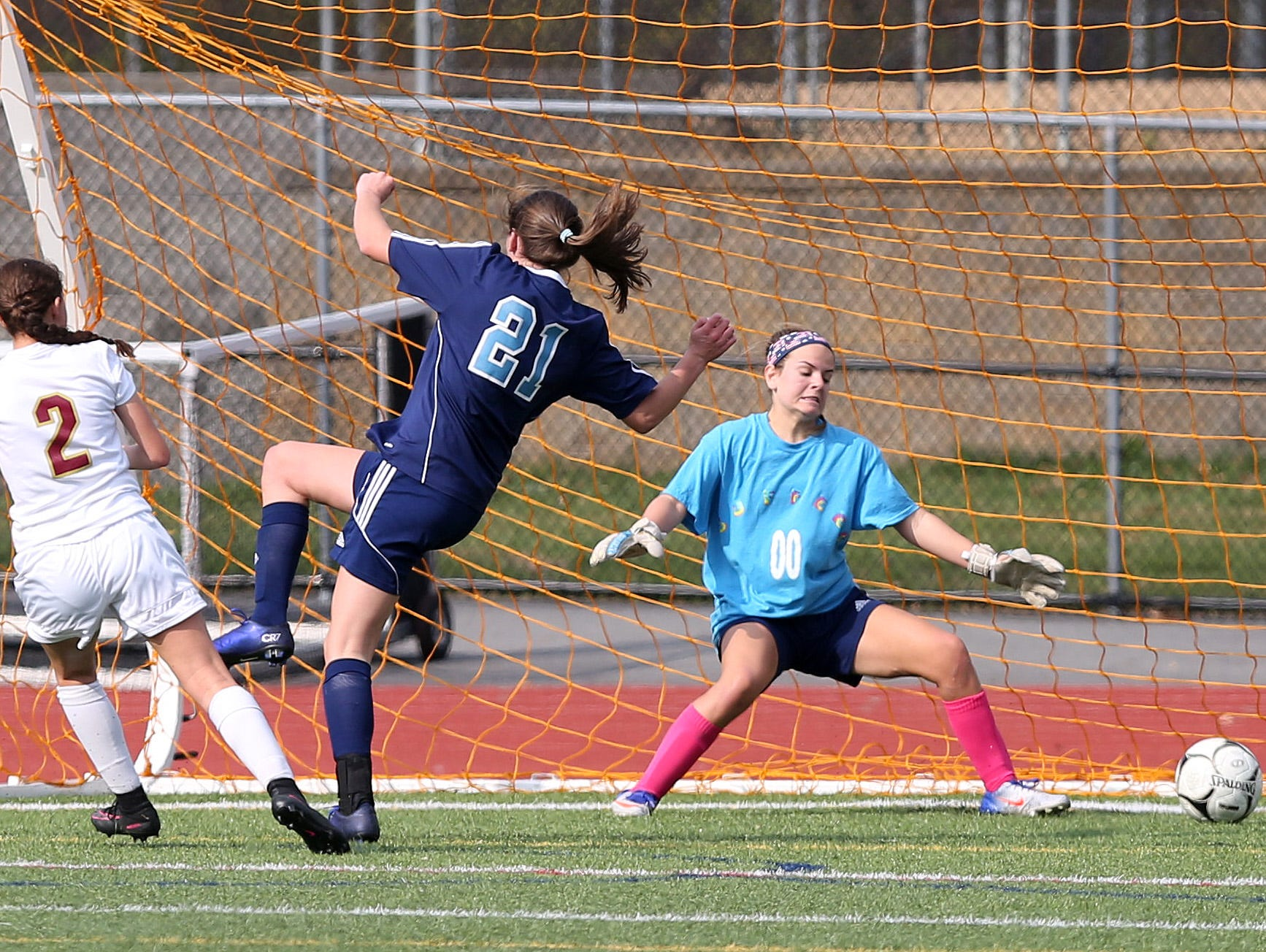 From left, Arlington's Meggie Buttinger (2) gets a shot by Suffern goal keeper Morgan Tamburro during the girls soccer Section 1 Class AA championship game at Yorktown High School Oct. 30, 2016. Arlington won the game 2-0.