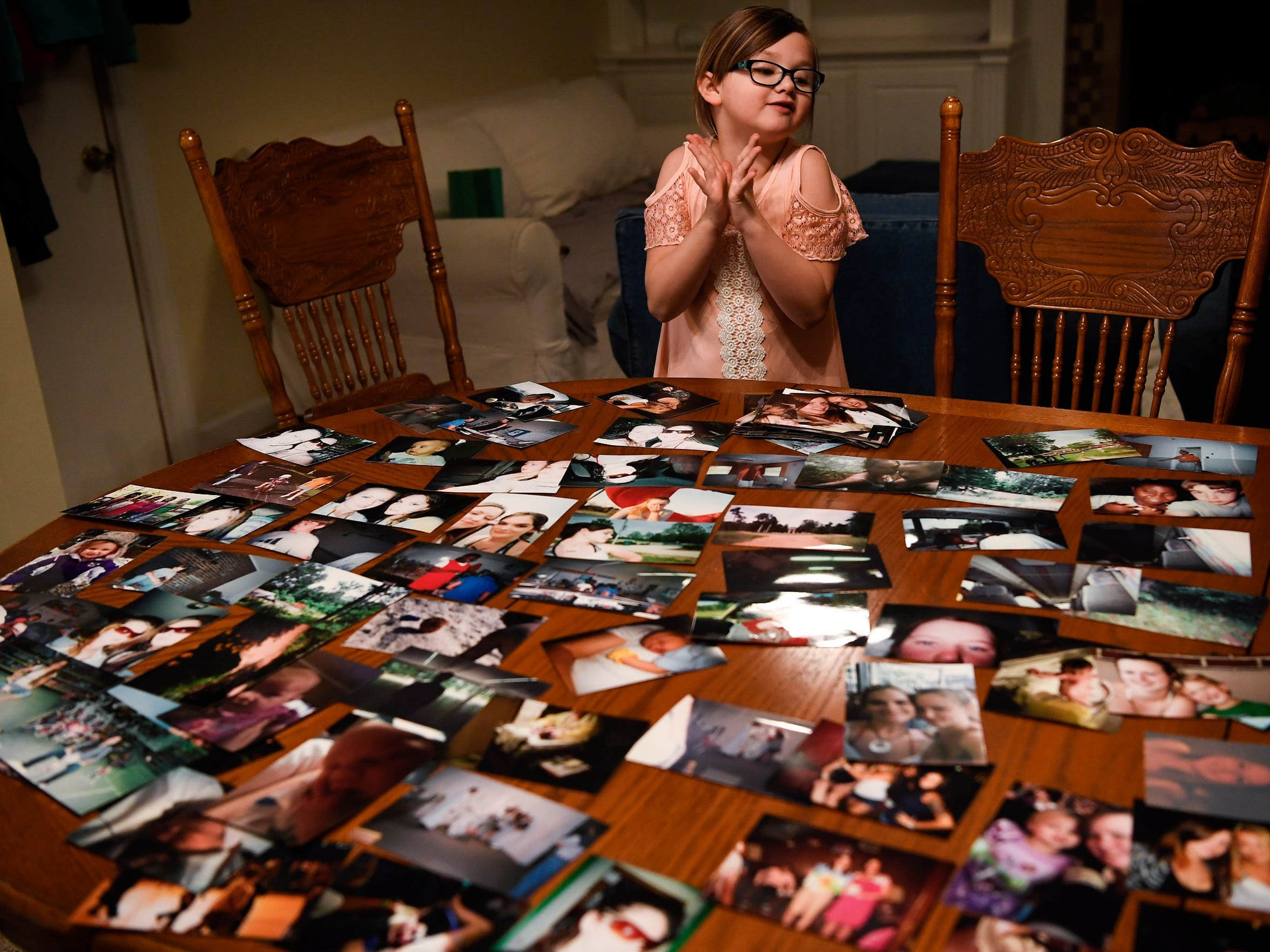 Braelyn Hardin reacts as she looks through pictures of her mother at her home in Donelson on March 20, 2018. Heather Baltz died in February at the age of 28 after battling an opioid addiction for years.