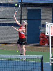 St. Philip's Alexi Behnke serves during early action