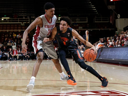 Oregon State guard Stephen Thompson Jr., right, is defended by Stanford forward Marcus Sheffield during the first half of an NCAA college basketball game Wednesday, Feb. 22, 2017, in Stanford, Calif. (AP Photo/Marcio Jose Sanchez)