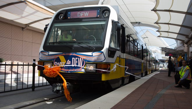 An image of a DART light rail train ahead of the lines opening of a station at the Dallas/Fort Worth International Airport.