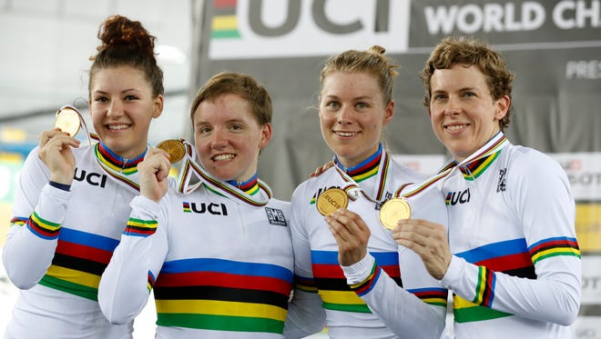 Chloe Dygert (left) shows off her gold medal won with the United States women's team pursuit team at the World Track Cycling championships in Hong Kong, Friday.