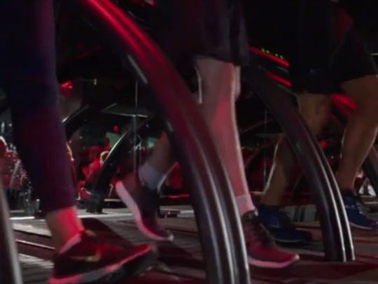 Runners go backwards in Barry's Bootcamp.
