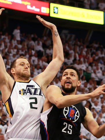Jazz forward Joe Ingles, left, tries to stop Clippers