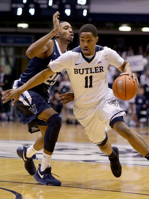Butler Bulldogs guard Kethan Savage (11) drives around Villanova Wildcats guard Mikal Bridges (25) in the first half of their game Wednesday, December 4, 2016, evening at Hinkle Fieldhouse.