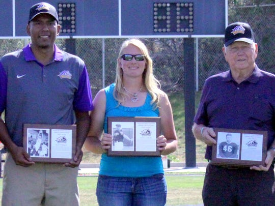 Matt Enriquez and Angela Corliss and Lee Barnes, from left, were inducted into the WNMU Athletic Hall of Fame on Saturday as part of the Homecoming celebration.