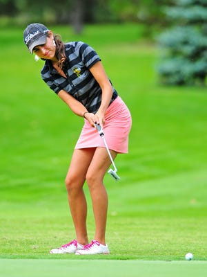 Green Bay Preble's Maddy Neumeier putts during an invitational meet last Thursday at Highland Ridge Golf Club.