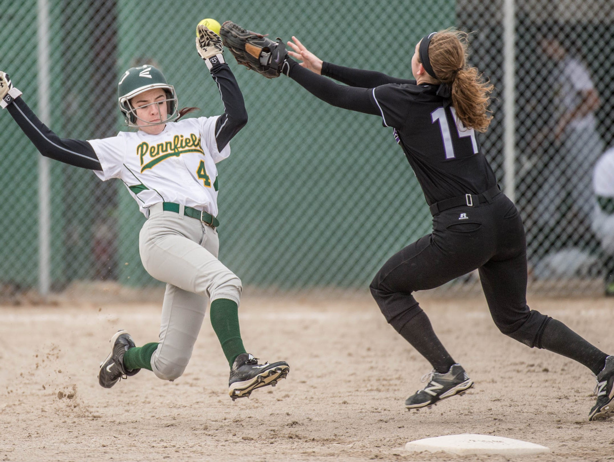 Lakeview's Kim Kucharczyk (14) goes for the ball as Pennfield's Lexi Purvis (4) slides into second.