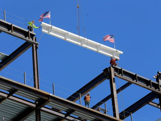 Jersey Shore University Medical Center installs the final steel beam for its HOPE Tower Center, a new $265 million facility on its east campus that will provide outpatient services in 2018, at Jersey Shore University Medical Center in Neptune, NJ Thursday September 15, 2016.