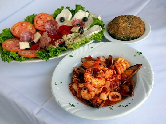 Antipasto Vittoria, zuppa di pesce and stuffed artichoke at Villa Vittoria, which will be open Christmas Day.