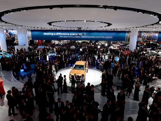 The 2019 Ford Ranger on display as people walk and