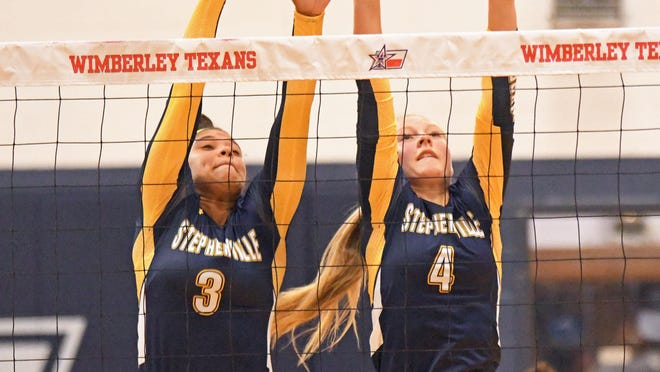 Stephenville High School senior Alee McClendon (3) and junior Kennedy Coffee (4) try to block a shot during a volleyball match played Friday at Wimberley High School.