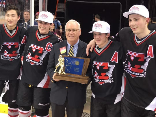 Northern Highlands hockey captains (from left) Jin Lee, Joe Konvit, Sean Vlasich and Henry Riccitelli accept the trophy for winning the Public B state championship at Prudential Center on Monday, March 5, 2018.