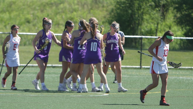 Christian Brothers celebrates after a first-half goal during a New York State girls lacrosse Class A state semifinal game against North Rockland at Tompkins Cortland Community College  in Dryden on Friday, June 10th, 2016. Christian Brothers won 14-8.