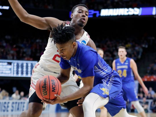 South Dakota State guard Brandon Key, front, tries to keep the ball in-bounds as he gets past Ohio State forward Andre Wesson during the first half of a first-round game in the NCAA college basketball tournament, Thursday, March 15, 2018, in Boise, Idaho. (AP Photo/Ted S. Warren)