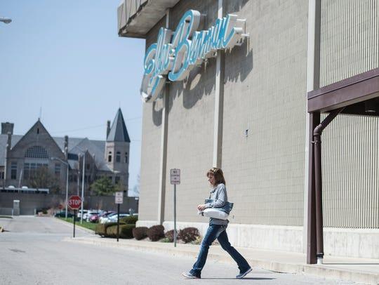 A shopper walks out of Elder-Beerman, 601 E. Main St.,