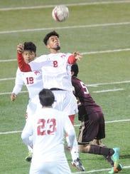 Cooper's Izac Faraci (8) heads the ball while teammates