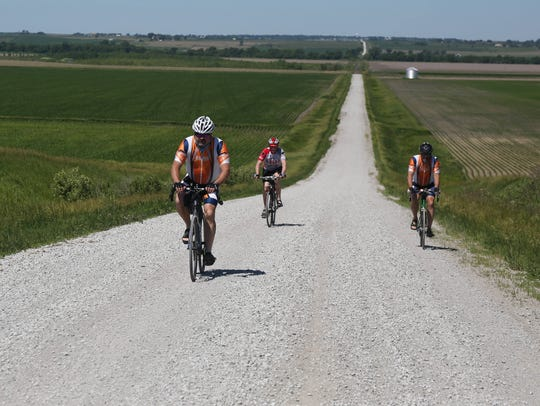 Members of the RAGBRAI route inspection team take on