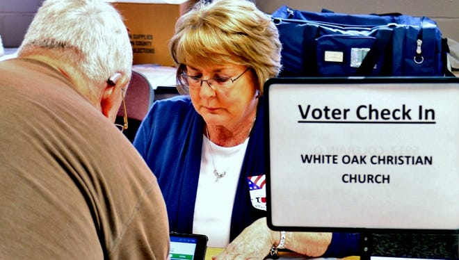 A voter checks in at White Oak Christian Church, which houses Colerain precincts G, Q and FF on May 2.