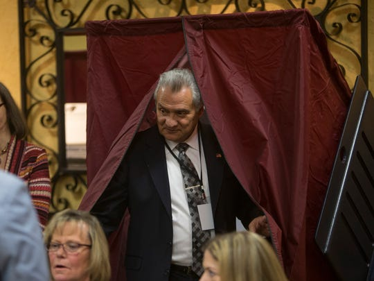 Ovean County Freeholder Joe Vicari leaves the voting