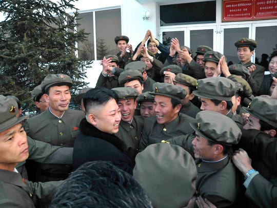 North Korean leader Kim Jong Un (center) celebrates