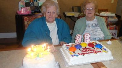 Twins Laura Quairoli (left) and Norma Stanker were honored on Nov. 5 by more than 40 family members and friends at a surprise 98th birthday celebration at Spring Oak Assisted Living of Vineland.