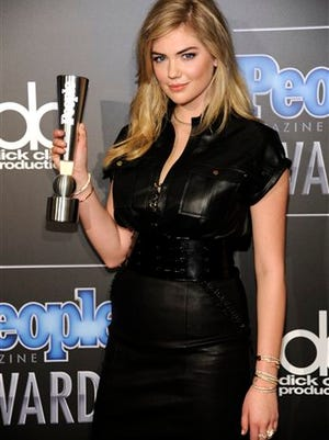 """Kate Upton poses backstage with the award for """"Sexiest Woman"""" at The People Magazine Awards at the Beverly Hilton hotel on Thursday, Dec. 18, 2014, in Beverly Hills, Calif."""