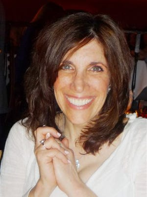 This photo provided by the Brody family shows an undated photo of Ellen Brody who was killed in the SUV that was hit by the train in New York Tuesday. The National Transportation Safety Board is looking into how familiar the SUV driver was with her car and her route, whether she was using a cellphone and whether the backed-up traffic played a role.
