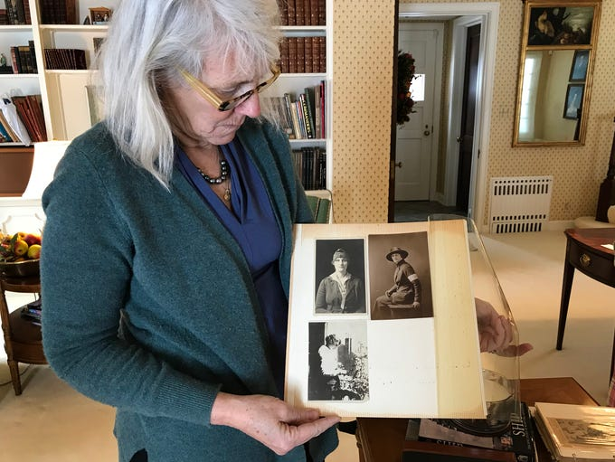 Elizabeth Goessling looks at photos of her grandmother,