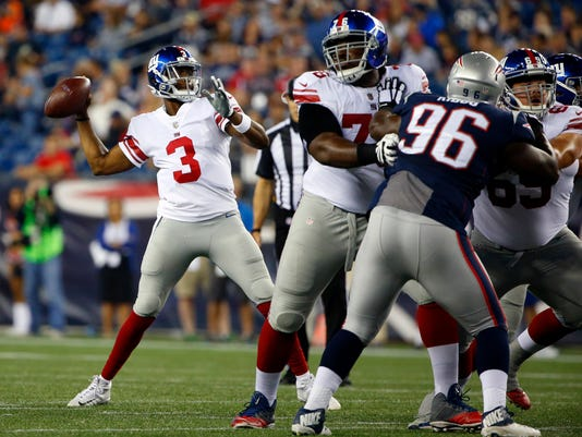 New York Giants quarterback Geno Smith (3) passes under pressure from New England Patriots nose tackle Darius Kilgo (96) during the first half of an NFL preseason football game, Thursday, Aug. 31, 2017, in Foxborough, Mass. (AP Photo/Winslow Townson)