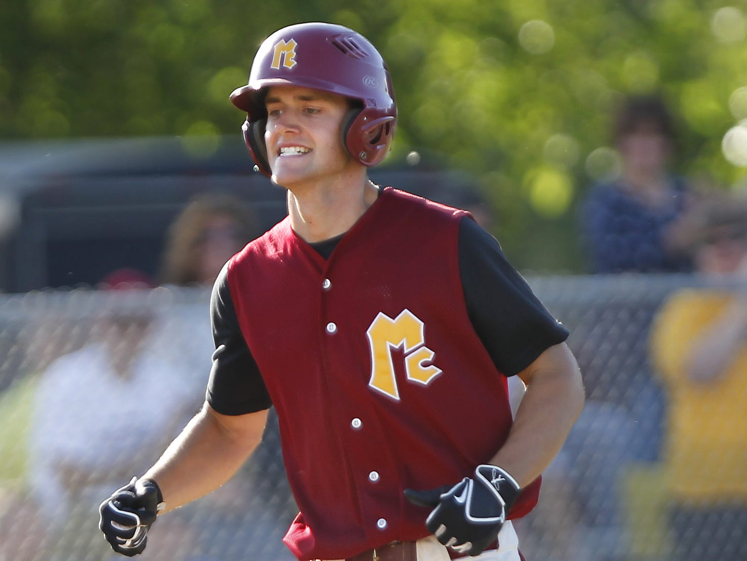McCutcheon's Braden Giroux is all smiles as he heads for home plate after hitting a two-run home run in the bottom of the third inning against Harrison in the North Central Conference baseball championship Monday, May 18, 2015, at McCutcheon High School. Giroux's homer put the Mavericks up 7-1 at the time. McCutcheon went on to beat Harrison 10-1. This is the first year in the NCC for both teams.