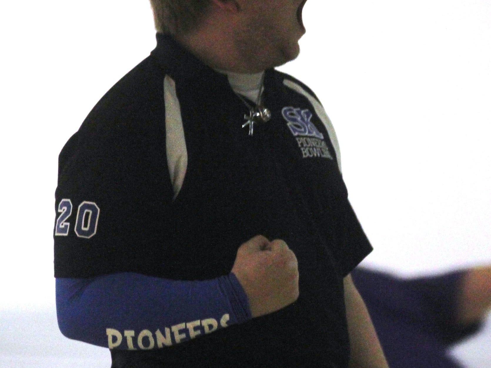Brian Fecher of Simon Kenton pumps up his teammates during the team tourney Feb. 13.