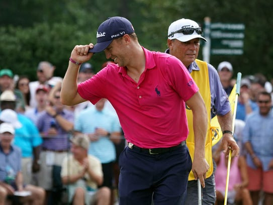 Justin Thomas reacts after making a putt on the 10th