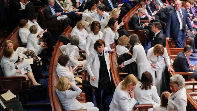 House Democratic congresswomen, wearing white, take their seats Tuesday before President Donald Trump's speech to a joint session of Congress.