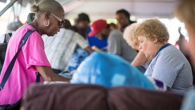 Veterans get help in the form of clothing, grocery and contact with social services at the Stand Down event in 2016. The event has continued to expand moving from the Muncie Mission to the Delaware County Fairgrounds.