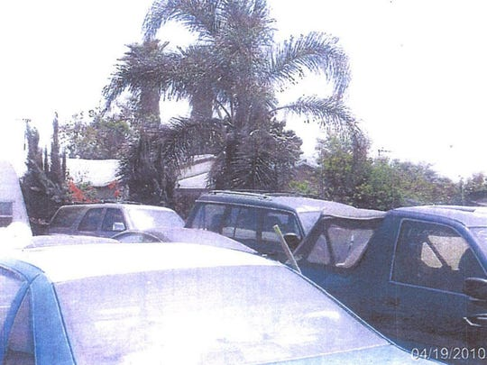 Cars are stockpiled at an illegal scrapyard on Peter Nolopp's property in a 2010 photo taken by Fontana city inspectors.