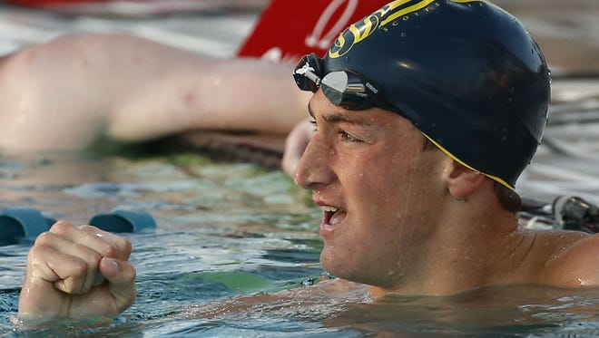 """Scottsdale Chaparral swimmer Ryan Hoffer pumps his fist after winning the Men's 100 Meter Freestyle """"B"""" Final at the Arena Pro Swim Series at the Skyline Aquatic Center in April."""