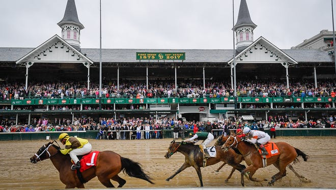Leaders run past the twin spires during the eighth race at Churchill Downs in May 2016.