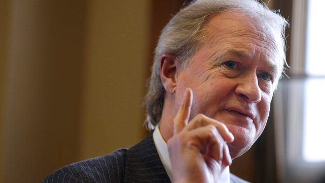 "In this Dec. 11, 2014 file photo, then-Rhode Island Gov. Lincoln Chafee responds to questions during an interview with The Associated Press, in his office at the Statehouse, in Providence, R.I.  Chafee says he has formed an exploratory committee to consider a Democratic presidential campaign, saying in a video that voters want to ""assess the character and experience of those offering ideas."""