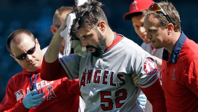 Los Angeles Angels starting pitcher Matt Shoemaker is assisted off the field after being hit by a line drive from Seattle Mariners' Kyle Seager in the second inning  Sunday in Seattle.