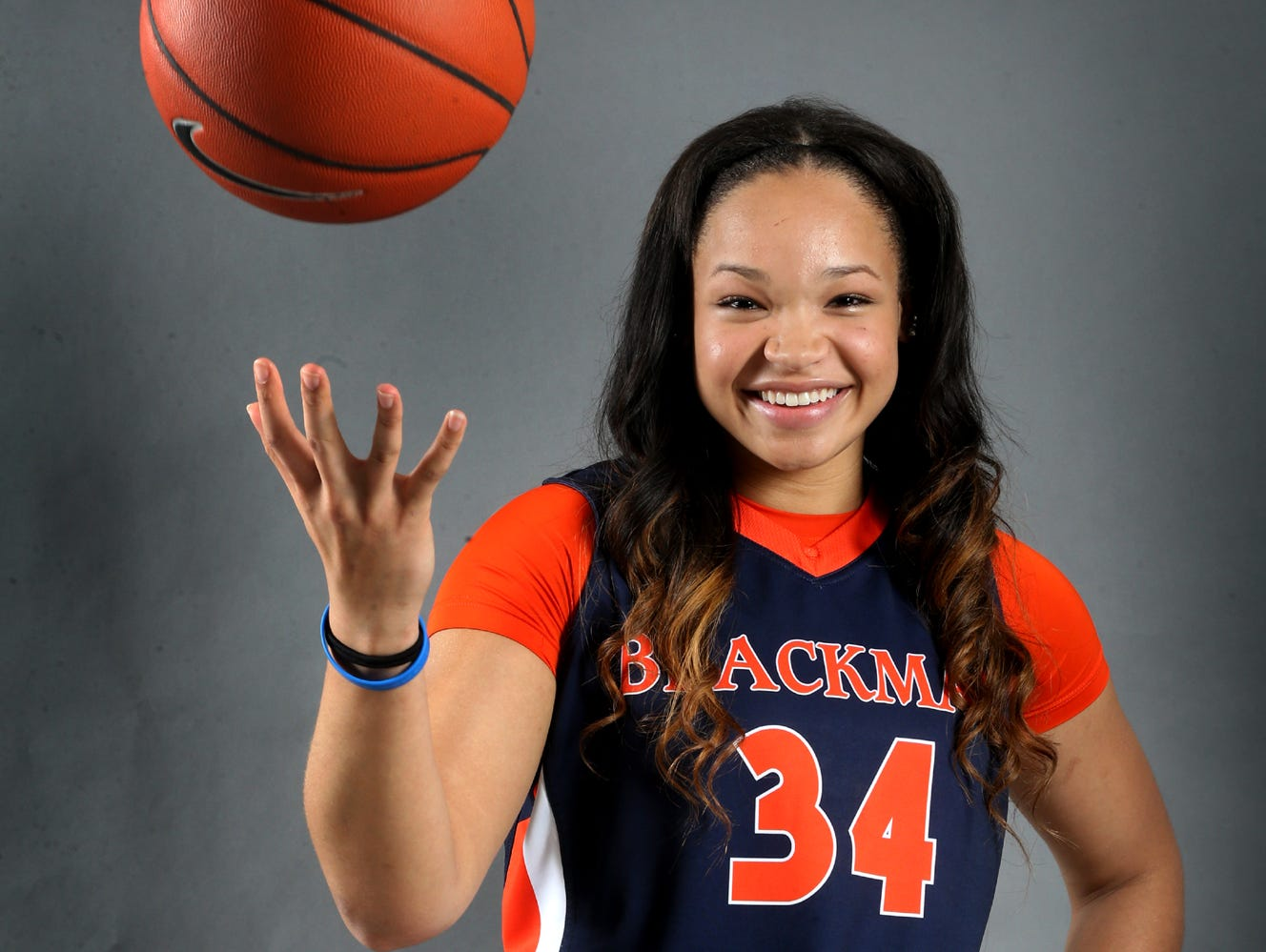 Alexis Johnson is one of the players on the all-area girls basketball team. Photo shot in the studio on April 9, 2015.