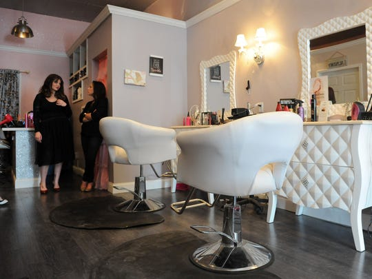 From left, Jessica Hennessey, owner, and Jackie Matheney wait for appointments to come in Friday at La Bella Vita salon, located on McIntire Avenue in Zanesville. The salon, which opened Jan. 1, offers services such as an aromatherapy oxygen bar, blow dry service, milk baths and aesthetician services.