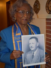 Ellie Dahmer holds a photograph of her late husband,