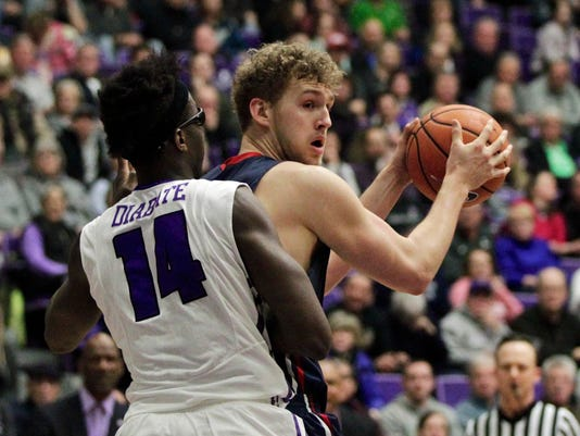 Saint Mary's center Jock Landale, right, looks to pass as Portland forward Tahirou Diabate defends during the first half of an NCAA college basketball game in Portland, Ore., Saturday, Feb. 17, 2018. (AP Photo/Steve Dipaola)
