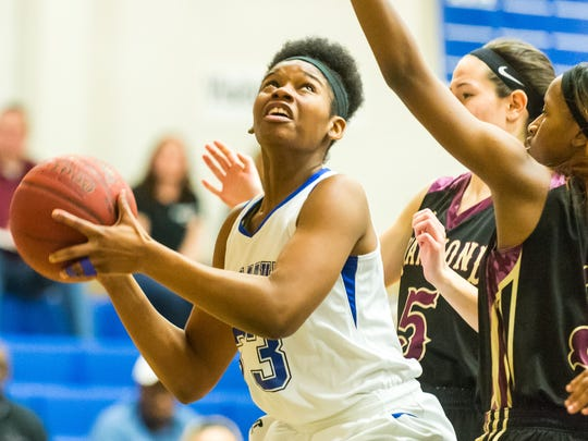 Stephen Decatur forward Amya Mumford (33) looks to shoot against Hammond in the MPSSAA playoffs at Stephen Decatur High School on Monday, March 1.